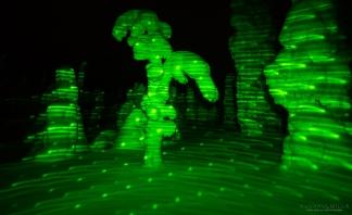Kuusamon Konttaisella laserpointterilla vihreäksi värjätty tykkylumimaisema.